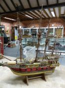 A PAINTED WOODEN MODEL FOUR MASTED GUN SHIP BRASS LABELLED REVENGE 1577 FOR RICHARD GRENVILLE,