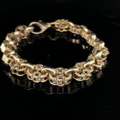 A 9ct YELLOW GOLD ENGRAVED ANTIQUE STYLE LINK BRACELET. LENGTH 22cms. WEIGHT 26.6grms.