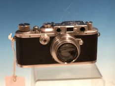 A LEATHER CASED LEICA IIIA CAMERA, No. 203424, WITH SUMMAR f=5 1:2 LENS No. 409046