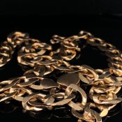 A 9ct GOLD CURB NECKLACE, LENGTH 56.5cms, WEIGHT 34.5grms.