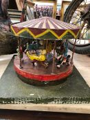 AN APPARENTLY SCRATCH BUILT HAND CRANKED AUTOMATON MERRY-GO-ROUND. Dia. 25cms.