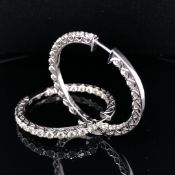 A PAIR OF 9ct WHITE GOLD DIAMOND HINGED HOOP EARRINGS. FOURTEEN DIAMONDS INDIVIDUALLY SET ALONG