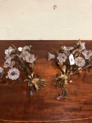 A PAIR OF GILT METAL AND CLEAR GLASS WALL LIGHTS, EACH WITH THREE LAMP SOCKETS AMONGST FLOWERS AND
