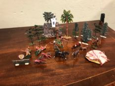 FIVE ELASTOLIN NATIVE AMERICAN WARRIORS, A LOG CABIN AND TOTEM POLE TOGETHER WITH LEAD TREES AND