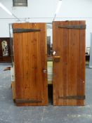 TWO ARTS AND CRAFTS PINE DOORS, EACH OF THE FOUR PLANKS JOINED AND NAILED WITH BLACKSMITHED STUDS