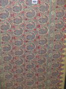 A FRAMED INDIAN CREAM GROUND TEXTILE PANEL WOVEN IN RED AND BLUE WITH FIVE ROWS OF BOTEH, THE FRAME.