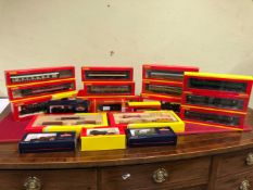 FOUR BOXED HORNBY 00 GAUGE ELECTRIC LOCOMOTIVES, TEN BOXED CARRIAGES, TWO BOXES OF ROLLING STOCK,
