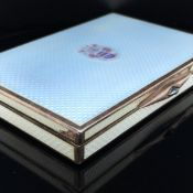 AN AUSTRO-HUNGARIAN SILVER GILT AND GUILLOCHE ENAMEL CIGARETTE BOX. THE TOP COVER WITH FINE ARMORIAL