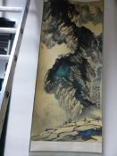 TWO UNMOUNTED CHINESE SCROLL PAINTINGS, ONE WITH HOUSES ON A MOUNTAIN SIDE. 65 x 43.5cms. THE