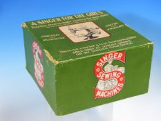 A BOXED SINGER SEWING MACHINE FOR GIRLS, A CARD DRAUGHTS BOARD WITH PLASTIC PIECES, VARIOUS BOARD