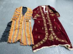 AN OTTOMAN RED VELVET KAFTAN SEWN IN GOLD THREAD WITH SCATTERED FLOWERS AND EDGING BANDS TOGETHER