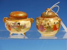 TWO SATSUMA KOROS, EACH PAINTED WITH TWO RESERVES OF FIGURES IN GARDENS ON GROUNDS OF FLOWER