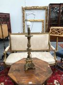A BAROQUE GILT WOOD CANDLESTICK TABLE LAMP, THE DOUBLE BALUSTER COLUMN ON THE SCROLL BASE OF