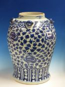 A CHINESE BLUE AND WHITE BALUSTER JAR WITH FOUR MASK HANDLES APPLIED TO A RUYI LAPPET BAND ON THE