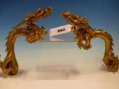 A PAIR OF CHINESE GILT BRONZE DRAGONS, THEIR ARCHED BACKS PERHAPS ONCE FORMING HANDLES. 23cms.