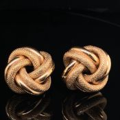 A PAIR OF 9ct GOLD LARGE TEXTURED KNOT EARRINGS TOGETHER WITH A FURTHER PAIR OF 9ct GOLD GEOMETRIC