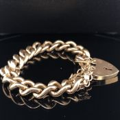 A 9ct SOLID GOLD VINTAGE CURB STYLE CHARM BRACELET, COMPLETE WITH PADLOCK AND SAFETY CHAIN. WEIGHT