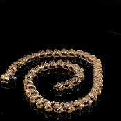 A 14ct GOLD AND DIAMOND LINE BRACELET, APPROX LENGTH 20cms, WEIGHT 9.7grms.