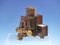 A 1930S SAYCE WATSON CAMERA BACKED BY A 35MM ROLL FILM MAGAZINE AND SLIDE FOCUSSING MECHANISM, THE B