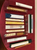 A COLLECTION OF NINE SLIDE RULES, TWO TRIANGULAR RULERS TOGETHER WITH TWO WOODEN AND PLASTIC FOLDING