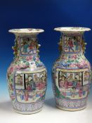 A PAIR OF 19th C. CANTON VASES PAINTED WITH COURT SCENE AND WARRIOR RESERVES ON A GROUND OF FRUIT,