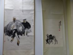 TWO CHINESE SCROLLS, ONE OF TWO DONKEYS. 66 x 43cms. THE OTHER PAINTED WITH A MAN AND CHILD WALKING.