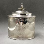 A GEORGE III HALLMARKED SILVER OVAL FORM HINGED LID TEA CADDY, WITH PINEAPPLE FINEALM ENGRAVED
