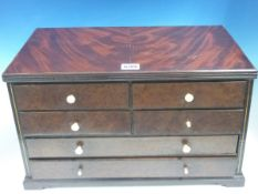 A MAHOGANY COLLECTORS CHEST OF SIX BURR WALNUT FRONTED DRAWERS AND ON BRACKET FEET. W 44 x D 25 x