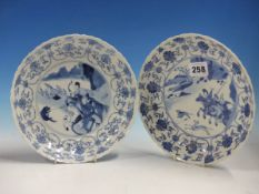 A PAIR OF CHINESE BLUE AND WHITE DISHES, THE FLUTED RIMS PAINTED WITH SCROLLING LOTUS ENCLOSING