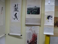 FOUR CHINESE SCROLLS PRINTED WITH CHERRY BLOSSOMS. 70 x 37cms. WITH A CRICKET ON A FLOWER STEM. 26.5