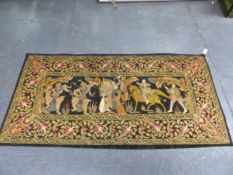 AN APPLIQUED BLACK GROUND PANEL, POSSIBLY BURMESE, A COLOURFUL BAND OF FLOWERS ENCLOSING TWO
