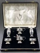 A HALLMARKED SILVER SIX PART CASED CRUET SET, DATED 1934 BIRMINGHAM FOR WILLIAM NEAL, COMPLETE