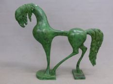 A GREEN PATINATED BRONZE STYLISED HORSE STANDING ON THREE LEGS. H 101cms.
