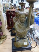 A PAIR OF ORIENTAL STYLE POTTERY KNEELING FIGURE TABLE LAMPS, TOGETHER WITH A CONTEMPORARY ALLOY