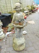 A BIRD BATH IN THE FORM OF A YOUNG GIRL HOLDING A LARGE SEA SHELL.