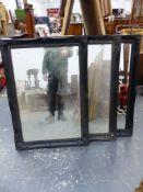 THREE EBONISED SWEPT FRAME BEVEL EDGE MIRRORS. 107 x 77cms (3).