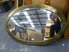 A LARGE ART DECO BRASS FRAMED OVAL BEVEL EDGE MIRROR, 100 x 64cms. TOGETHER WITH FOUR OTHER