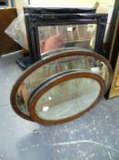 A PAIR OF EBONISED SWEPT FRAME BEVEL EDGE MIRRORS. 90 x 65cms. TOGETHER WITH TWO VINTAGE OAK OVAL