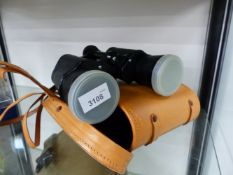 A PAIR OF BINOCULARS BY HARRISON PORTSMOUTH.
