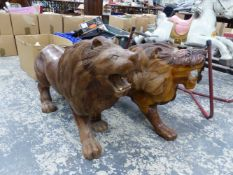 A PAIR OF LARGE CARVED HARDWOOD STANDING LIONS.