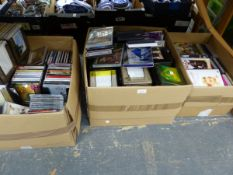 A LARGE COLLECTION OF CDS AND DVDS, VARIOUS TITLES.