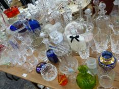 A LARGE COLLECTION OF GLASSWARES, TO INCLUDE EIGHT DECANTERS, DRINKING GLASSES, VASES, BOWLS ETC.