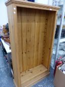 A SMALL PINE BOOKCASE WITH ADJUSTABLE SHELVES.