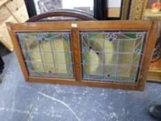 AN OAK FRAMED ARTS AND CRAFTS STAINED GLASS PANEL, 60 x 116cms.