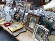 A QUANTITY OF DECORATIVE VINTAGE STYLE PHOTO FRAMES AND MIRRORS ETC.