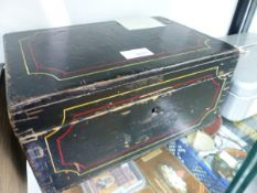 A BLACK PAINTED BOX OF SEWING MATERIALS, BUTTONS, COTTONS AND WOOLS.