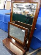 A GEORGE III MAHOGANY DRESSING TABLE MIRROR WITH TWO DRAWER BASE, AND A WALNUT FRAMED WALL MIRROR.