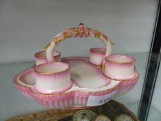 A ROYAL WORCESTER BLUSH PINK EGG CUP CRUET.
