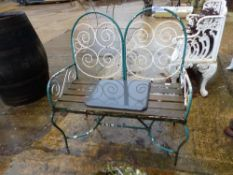 A PAINTED WROUGHT IRON GARDEN BENCH.