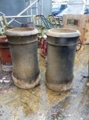 A PAIR OF LARGE CHIMNEY POTS.